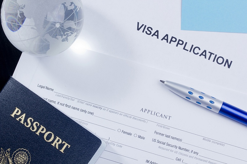 Directly above photograph of an application for a visa. ** Note: Shallow depth of field